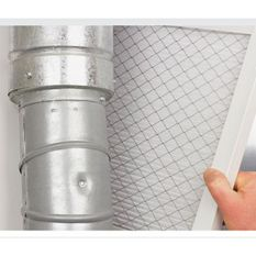 Checking the Filter in an Air Conditioning Unit in Red Deer.